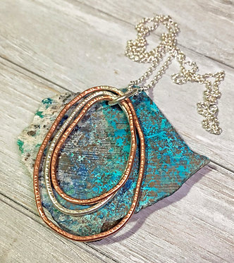 Textured copper and sterling silver pendant necklace.
