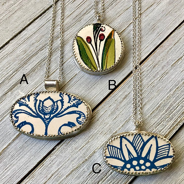 Ceramic and sterling silver pendants (from $70)