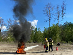 Retriev Technologies and Trail Firefighters Local 941 practice their fire extinguisher training