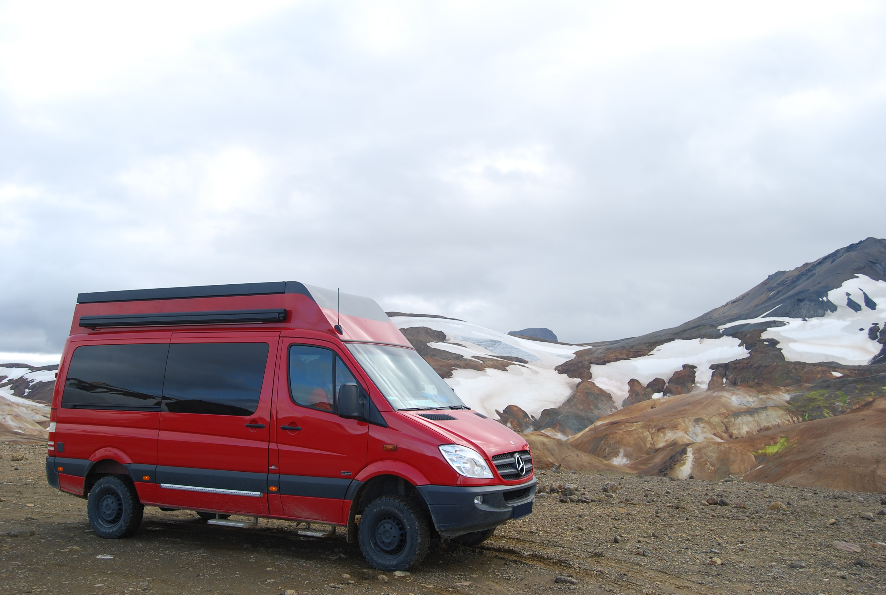 4x4 camper in snow mountains