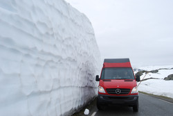 4x4 camper next to snow wall