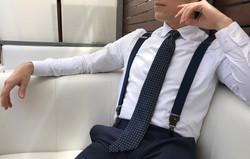 Man modeling ties and suspenders