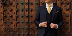 Man model in suit in front of a door