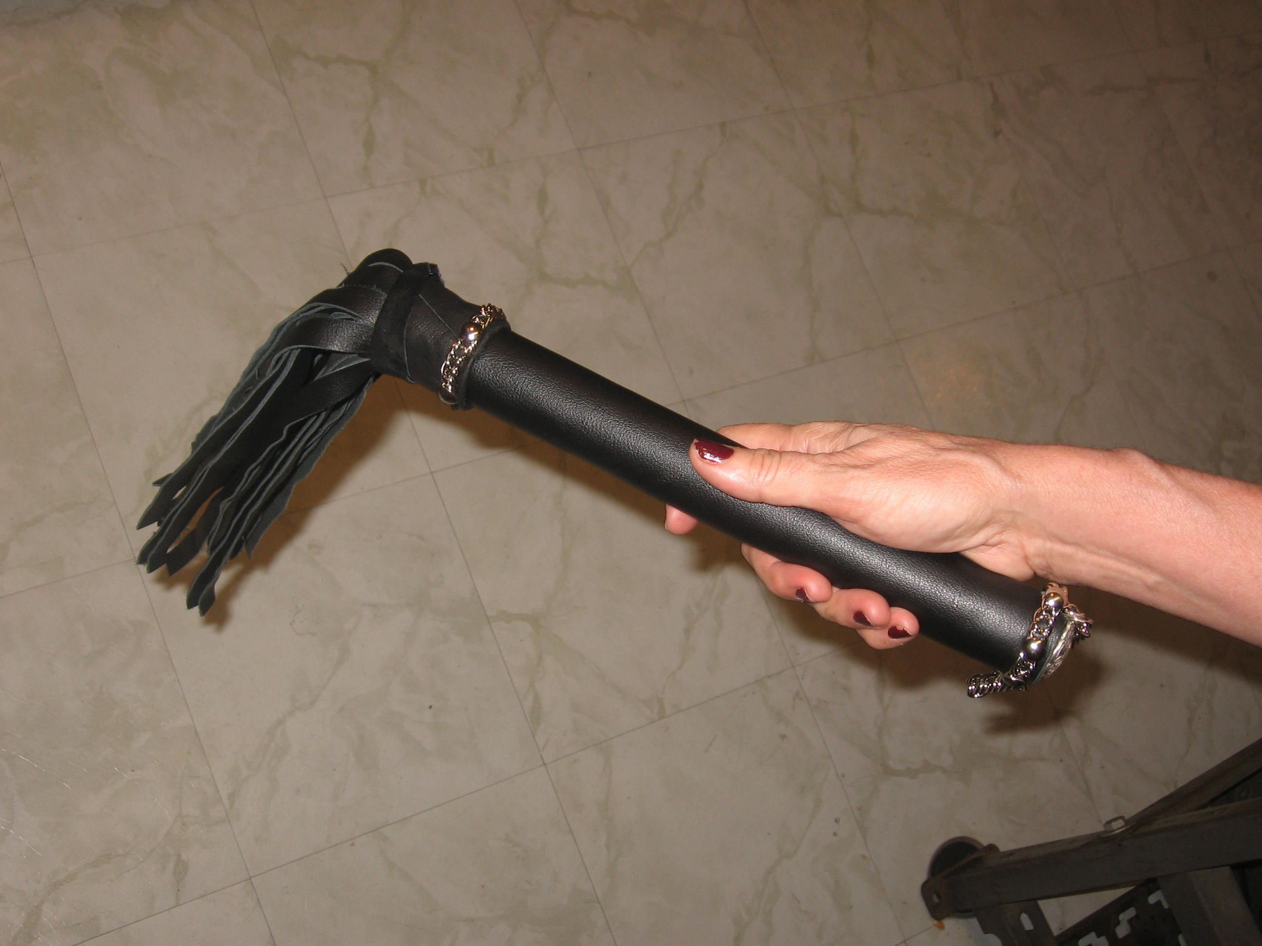 Handle of Custom Heavy Leather Flogger.jpg