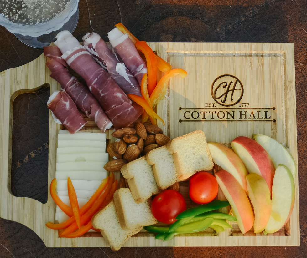 A Cotton Hall Charcuterie Board is the best welcome!