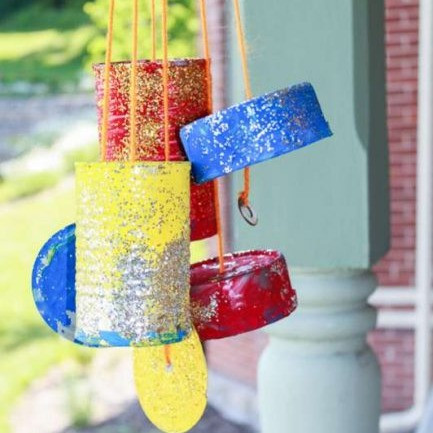 Colorful wind chimes made of upcycled tin cans.