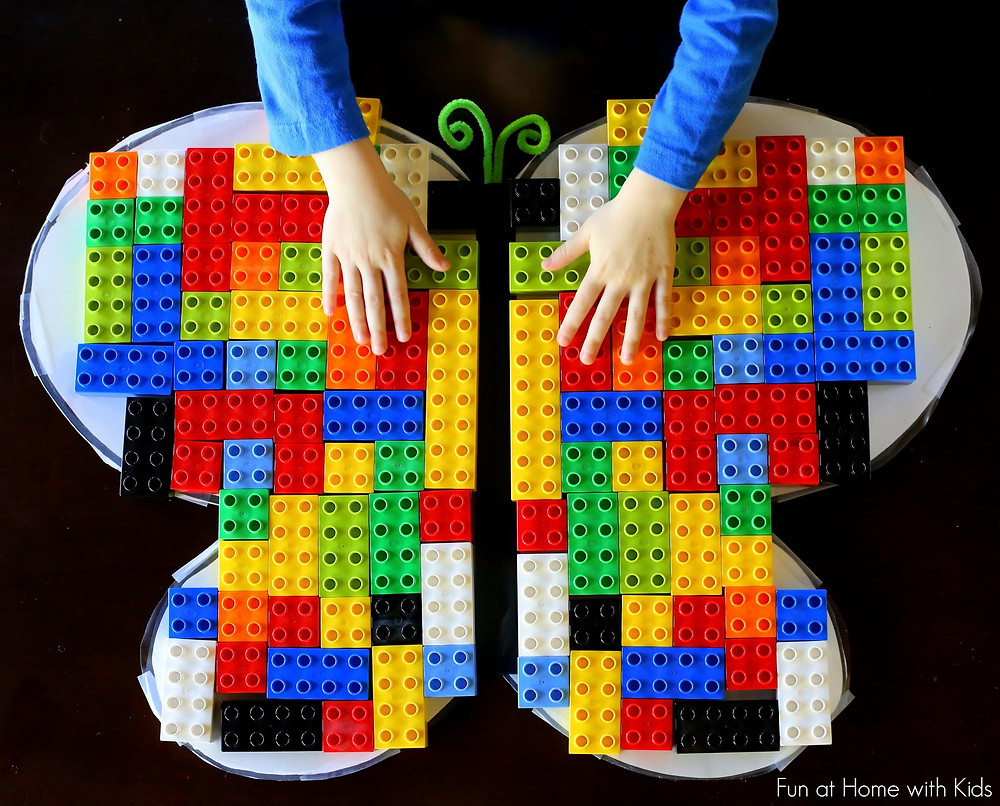 Colorful butterfly created by a child using legos.