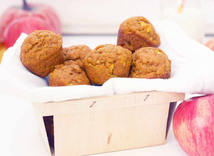 muffins stacked in a small wooden crate