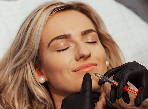 Patient receiving a dermal filler injection for a lip augmentation treatment at The Goddess Clinic Edinburgh
