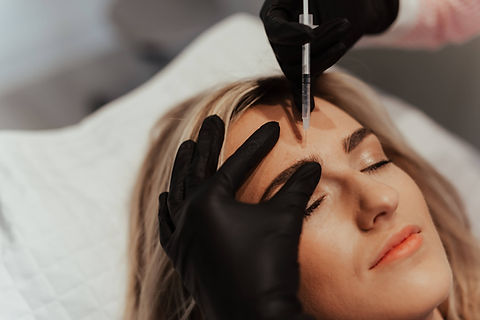 Patient receiving a botox anti-wrinkle injection treatment to her frown lines at The Goddess Clinic Edinburgh