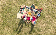 Aerial drone view of happy families havi