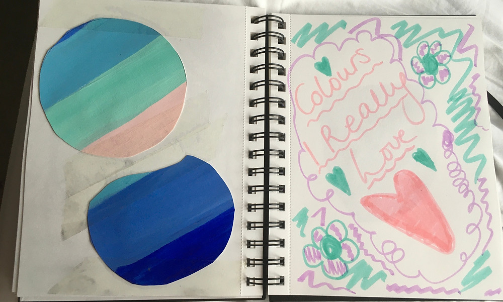 A photo of a carer's scrapbook, where they have doodled colours they love. The colours include shades of blue and peach. The words 'Colours I Really Love' are written in peach, with a peach heart drawn and coloured in underneath.