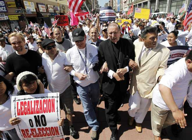 The Catholic Defender: Immigration and the American Nomads