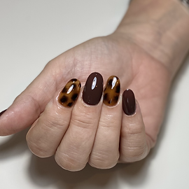 Tortie nail art over gel nails