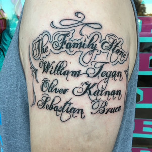 Script tattoo of The Family Stone