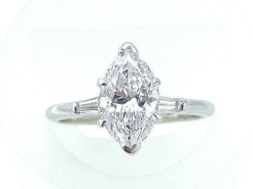 2.42 Carat Marquise Cut Diamond Ring With Tapered Baguettes.