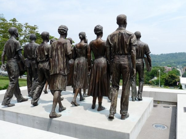 The Clinton Twelve's statues, posed as t