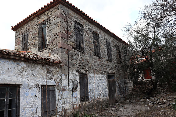 For sale in Eressos an old stone traditional house with many configuration possibilities