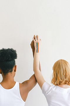 women-with-arms-raised-and-holding-hands