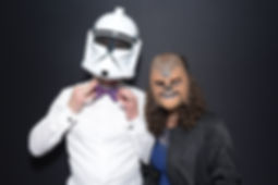 A couple with a Wookie mask and Clone Trooper helmet posing in a wedding photo booth in Snohomish County, WA.