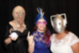 A bride and close friends dressed up from Dr. Who (Cybermen and Ood mask) in a photo booth in King County, WA.