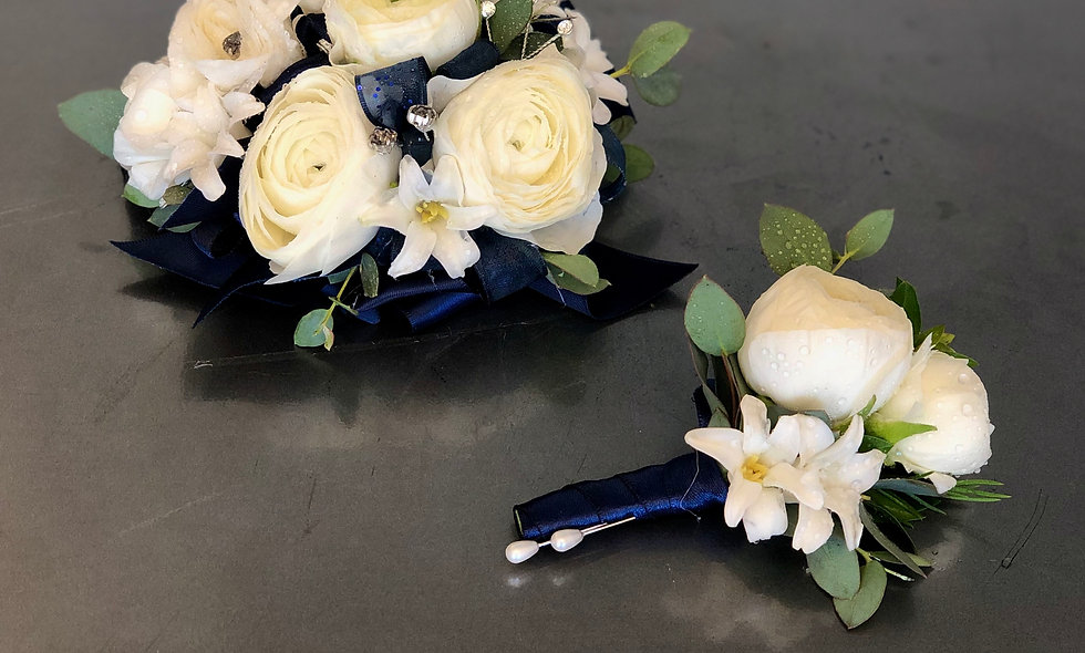 Premium navy and white prom corsage and boutonniere set.