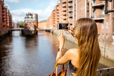 Young woman tourist photographing beauti