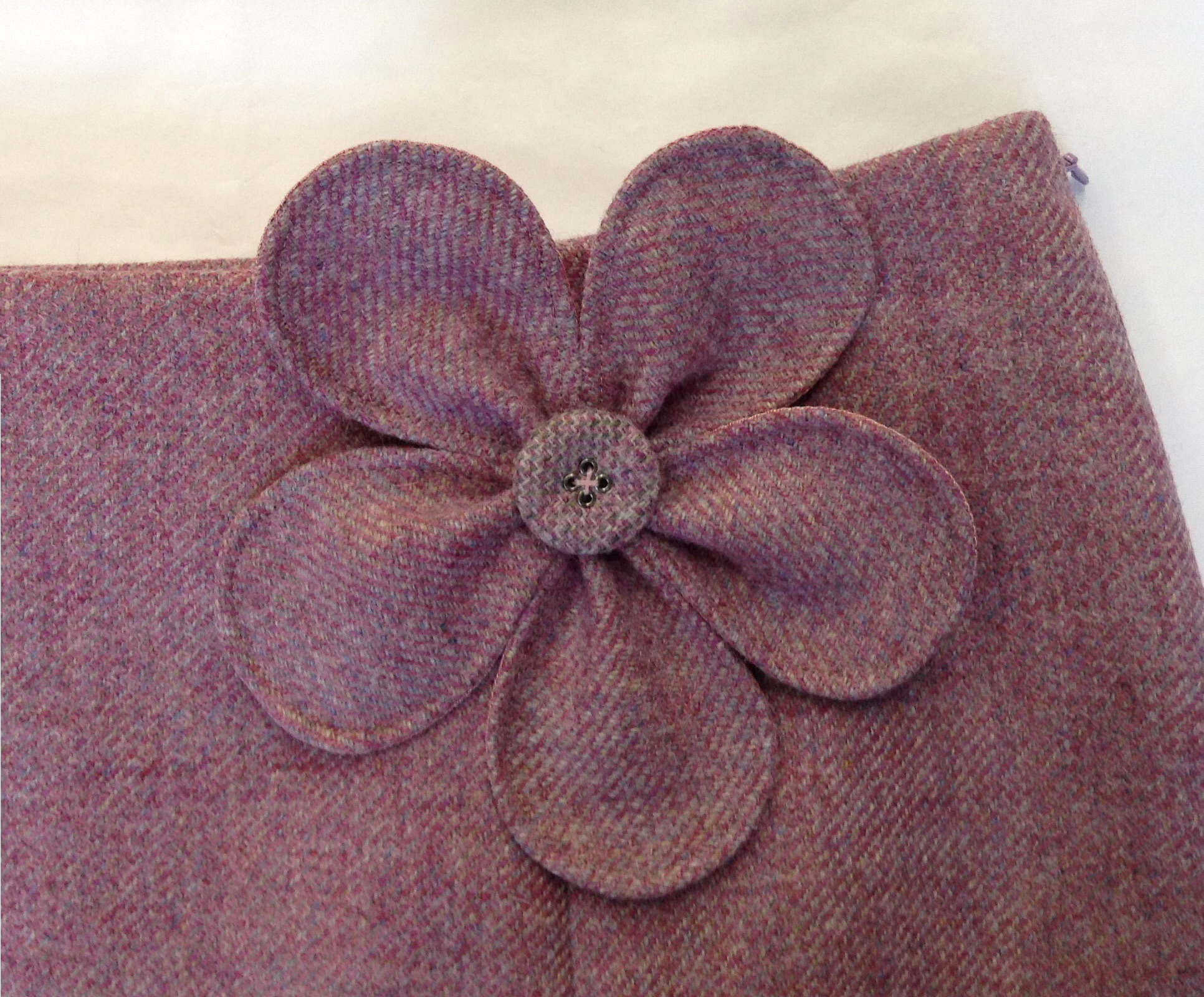 Tweed skirt with flower brooch