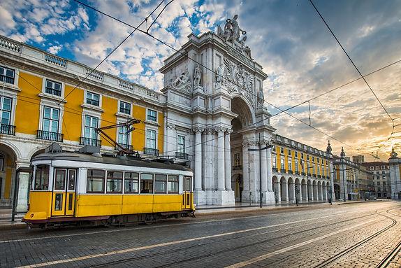 Historic yellow tram in front of Arco da Rua Augusta in Lisbon Portugal.jpg