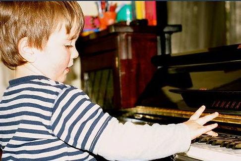 Photo of toddler Hugh playing piano_edited.jpg