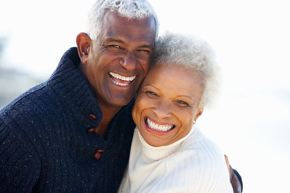 Romantic Senior Couple Hugging On Beach.