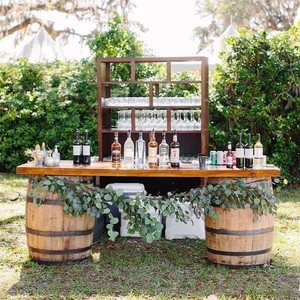 Barrel bar set up with foliage available to hire from The Drunken Jockeys