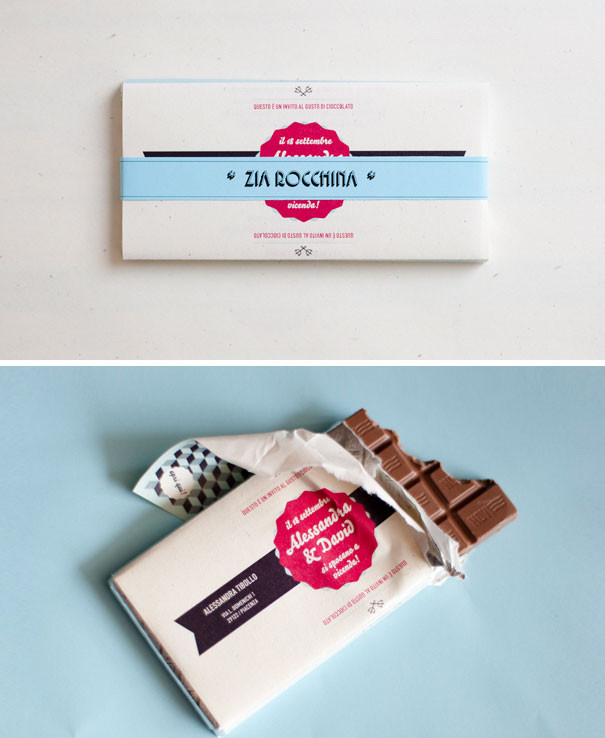 A chocolate bar wedding invite. The wrapper has all the wedding information designed with in white with accent colours of red and blue.