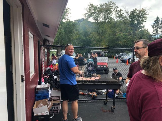 Dommer working the grill at Homecoming