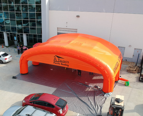 Custom Inflatables: A Team Roofing Tent Aerial Front