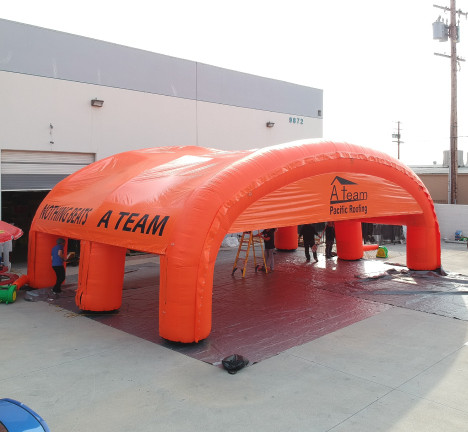 Custom Inflatables: A Team Roofing Tent Aerial Side