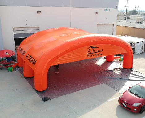Custom Inflatables: A Team Roofing Tent Aerial Angle