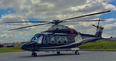 Large executive helicopter parked at air