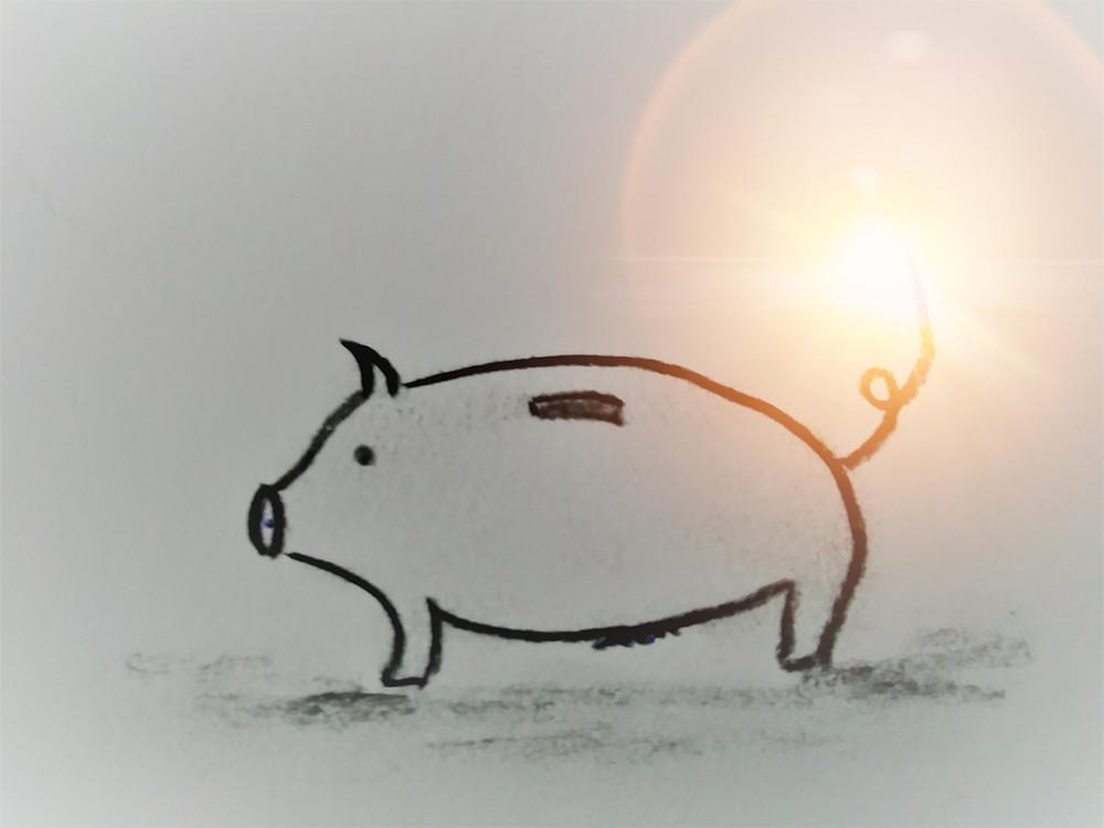 Een spaarvarken als symbool voor de tijd voor een burn-out.