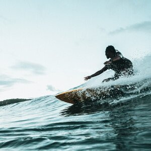 Surfing at Polzeath, one of the best things to do in Cornwall