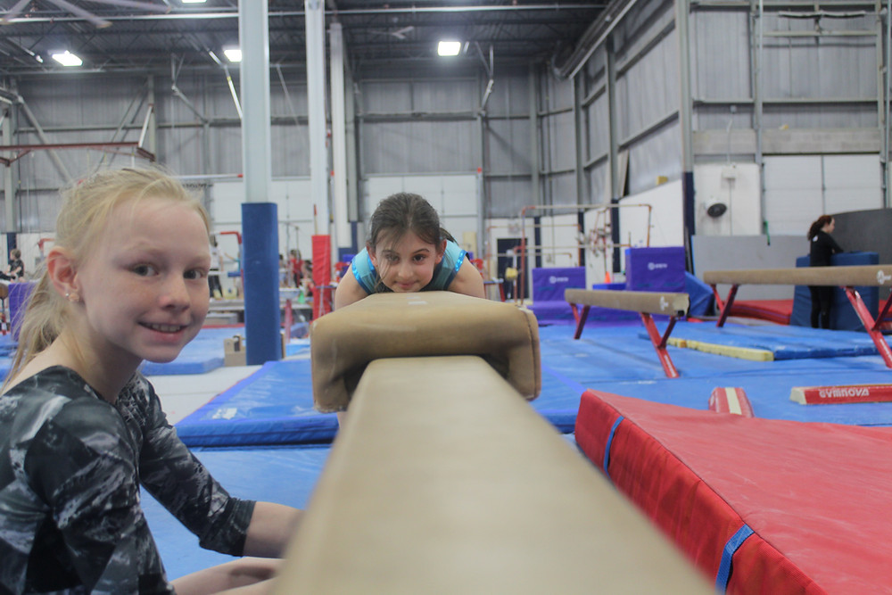 Gymnasts preparing for beam