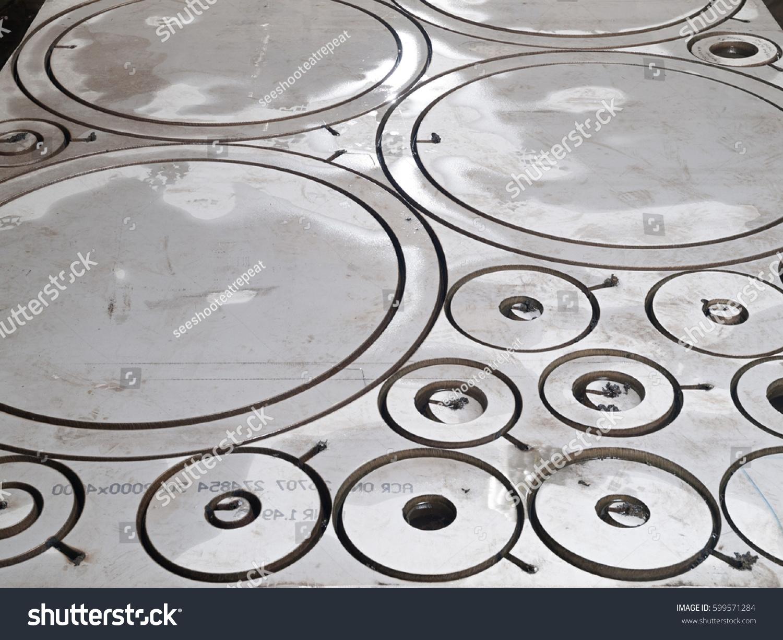stock-photo-stainless-steel-laser-cutout-circle-futuristic-shape-cutout-599571284