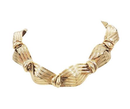 "Napier Goldtone ""Textured Ribbon"" Necklace, 1955 Ad Piece"
