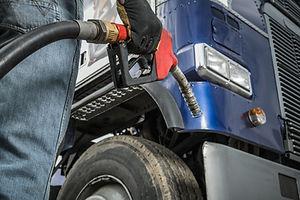 trucker-in-front-of-his-truck-preparing-