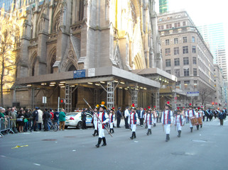 Marching in the NYC St. Patricks Day Parade by St. Patricks Cathedral