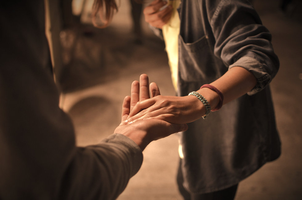 man and woman holding hands on street_ed
