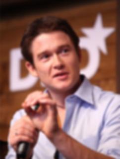 Casey_Fenton_Founder_upstock_speaking.png