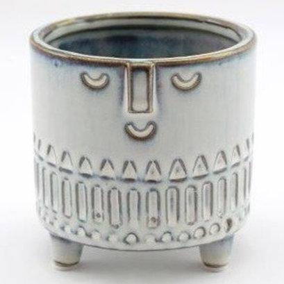 Glazed face pot