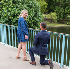 """Jake proposes to Courtney on the blue bridge in St James's Park London. Surprise proposal captured by Aurélie """"Photobya4"""" Four and featured in The Knot Proposals magazine."""