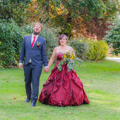 """Hugues and Morgane walk hand in hand in the garden of their wedding reception captured by Aurélie """"Photobya4"""" Four in France"""